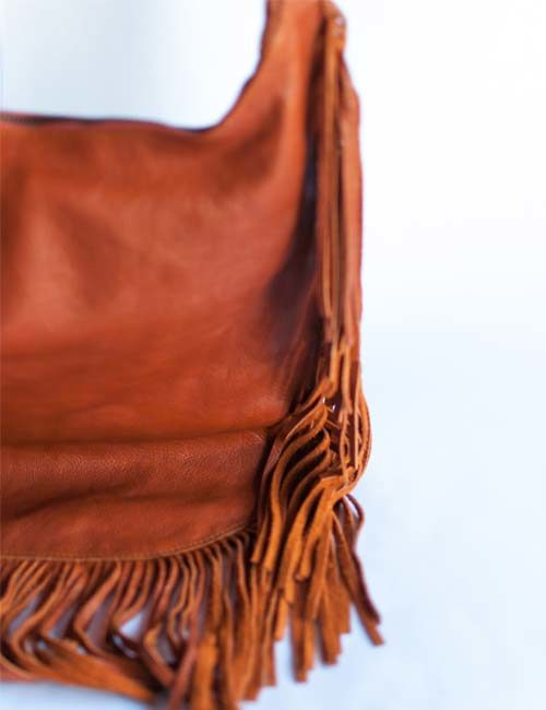 carin-genuine-leather-sling-bag-with-tassels-brown