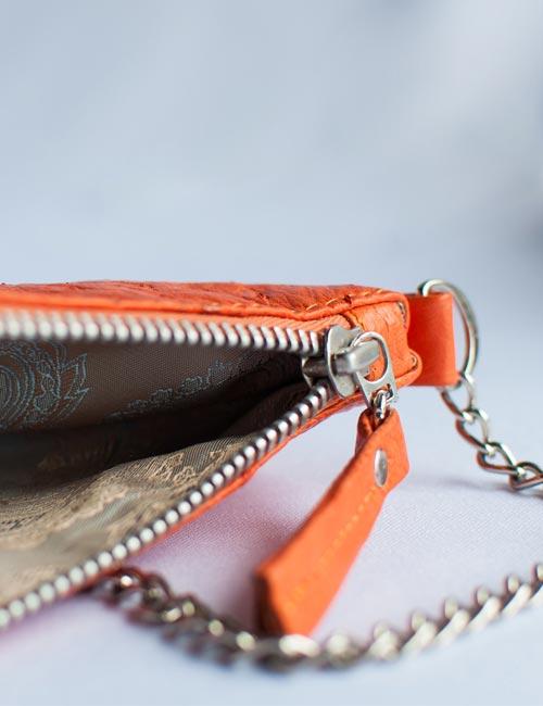 kate-small-ostrich-leather-handbag-orange