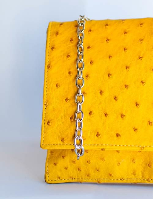 zeta-ostrich-leather-clutch-bag-yellow