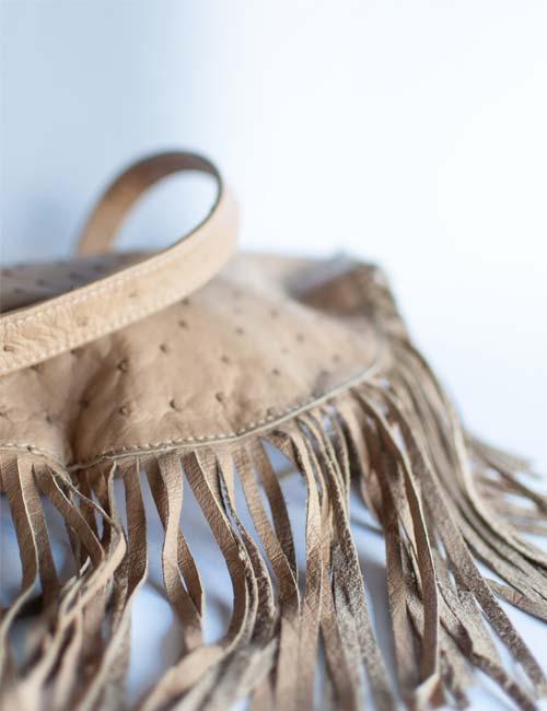 ellen-ostrich-leather-sling-bag-with-tassels