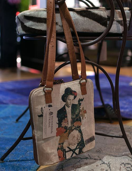 anele-brown-ostrich-leather-and-canvas-print-handbag-1